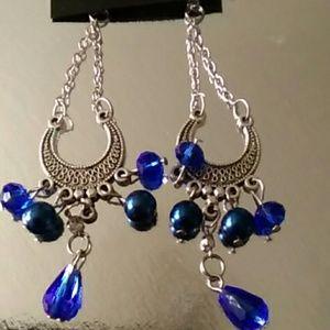 Hanging horse shoe earrings blue crystal